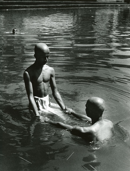 Two Men Holding Hands Black And White Two men with bald shaved heads
